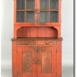 diminutive-pennsylvania-painted-pine-stepback-cupboard-ca-1810-appears-in-a-pumpkin-color-seen-at-pook-and-pook-auctions