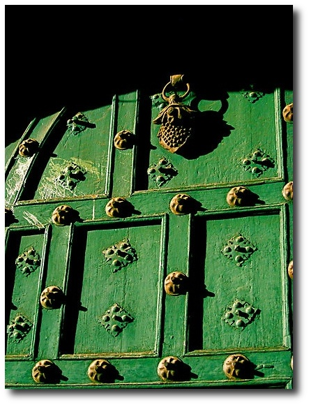 Rusty Hardware On A Painted Green Door