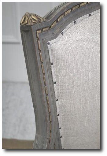 Upholstered In Linen With Nail Heads.