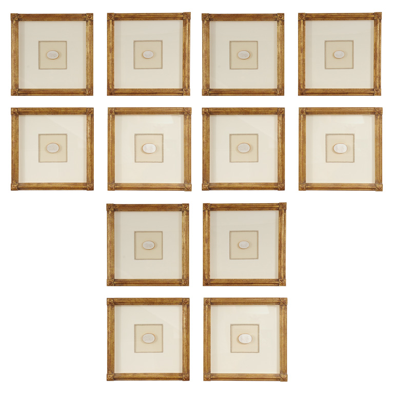a collection of 12 23kt giltwood museum quality frames containing a single neo classical intaglio in