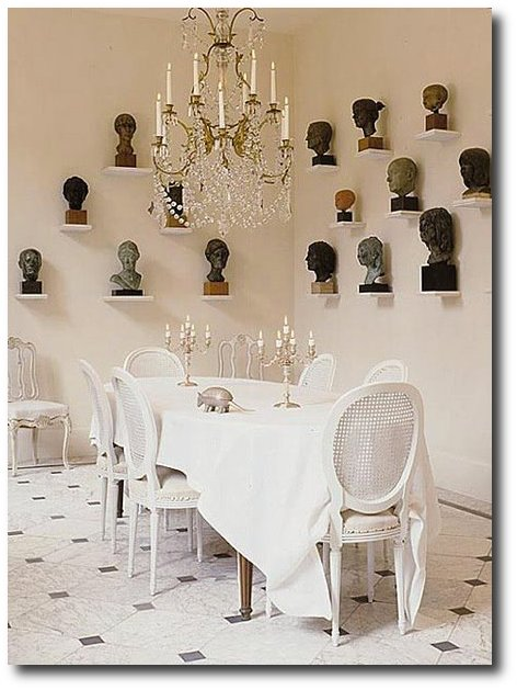 A collection of busts displayed on wall brackets, Designer Unknown