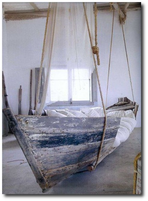 Repurpose A Leaky Wooden Boat Into Swinging Bed For Beach Cottage Style Porch Add